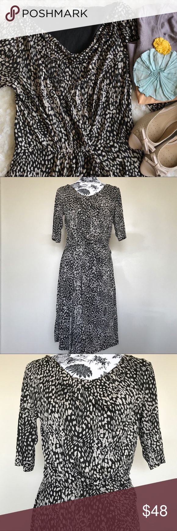 """Boden Leopard Print Ruched Dress Dress is in perfect condition! Soft Lyocell fabric dress eith full lining. Side zipper. Ruching at the waist creating draped neckline. Sleeves hit at the elbow. Bust measures about 16.5"""" and length at 41"""". 100% Tencel Lyocell. Boden Dresses Midi"""