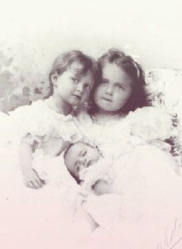 """A formal photosession taken in summer 1899 to commemorate the birth of Grand Duchess Maria Nikolaevna, third child and daughter of the last Tsar of Russia. The """"Amiable Baby"""" is here captured with her mother, Empress Alexandra Feodorovna, and her two elder sisters Grand Duchesses Olga Nikolaevna and Tatiana Nikolaevna."""