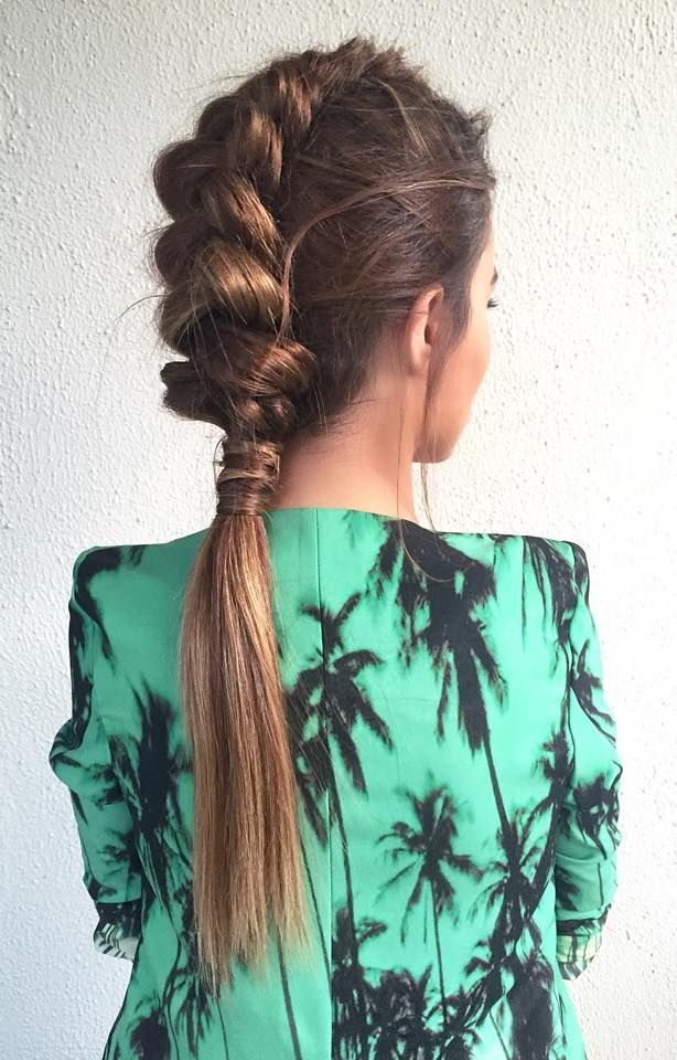 Pull all hair (besides section going to braid) into ponytail. Braid middle section, pancake, and secure to ponytail.