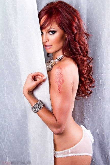 Christy Hemme plotting from behind the curtain 02