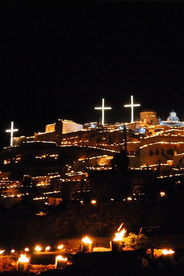 Epitafios (Greek Easter Friday) in Pyrgos, Santorini. The hillside is lit up with burning fire brands.