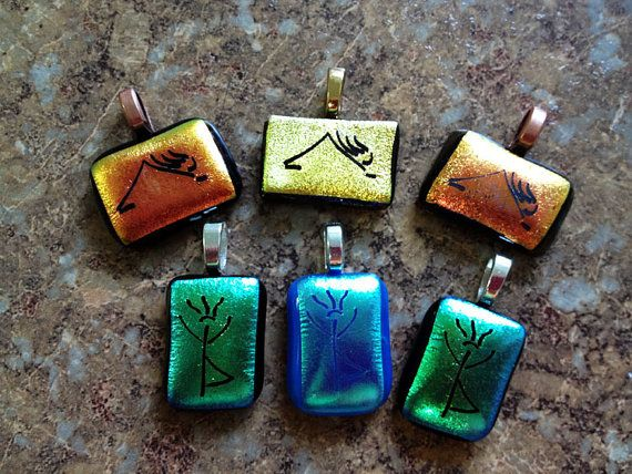 Yoga petroglyph poses in glass fusion by LikeYourJunk on Etsy, $20.00