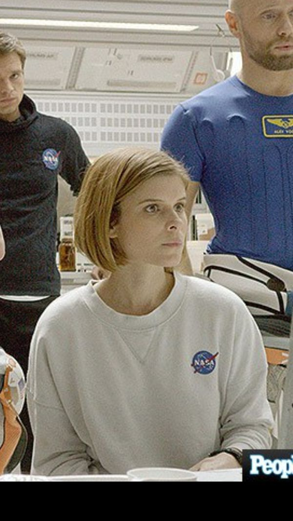 Love her hair! And her sweatshirt!