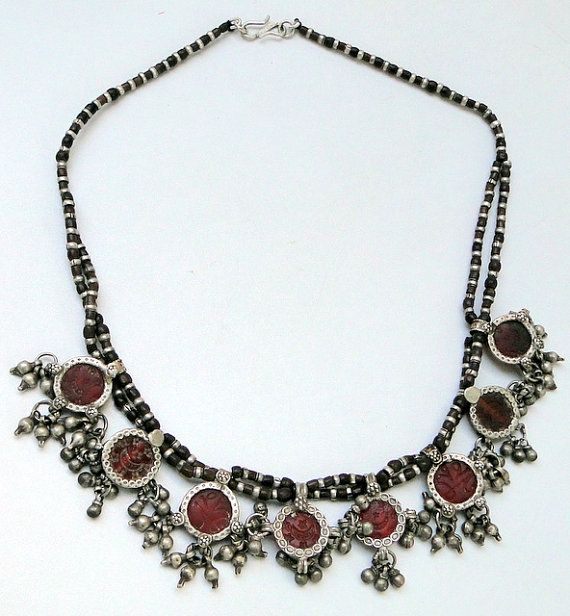 Old Indian silver necklace, combined with silver pendants with red color glass stones, wooden ,silver beads.