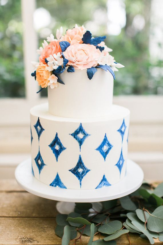 Gorgeous white and navy blue floral wedding cake.