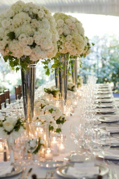 White garden roses and hydrangeas  Beautiful reception...Plan your dream wedding http://www.allaboutweddingplanning.com & honeymoon http://www.jevellingerie.com