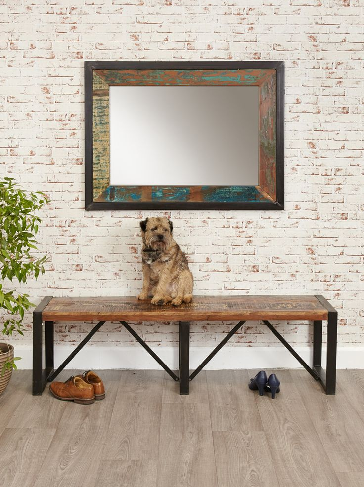 large wall mirror made from salvaged materials in an industrial style with steel frames along