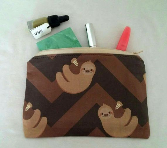 This precious lil' make-up case. | 27 Adorable Things Every Sloth Lover Needs