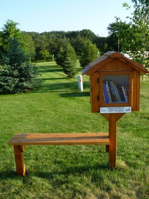 little free library with a bench