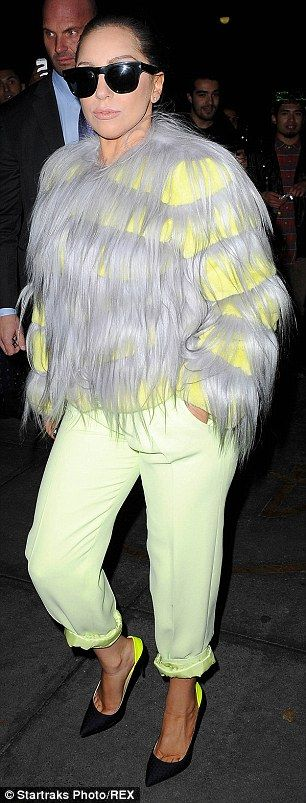 Highlighter bright: The Applause hitmaker also donned green sweatpants as she headed out in New York City