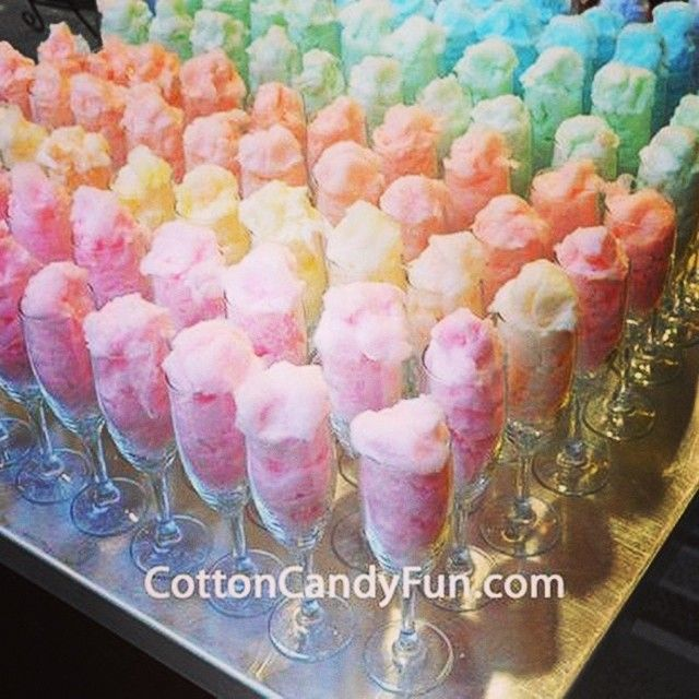 Cotton candy in champagne flutes. Pour the champagne over the cotton candy!                                                                                                                                                     More