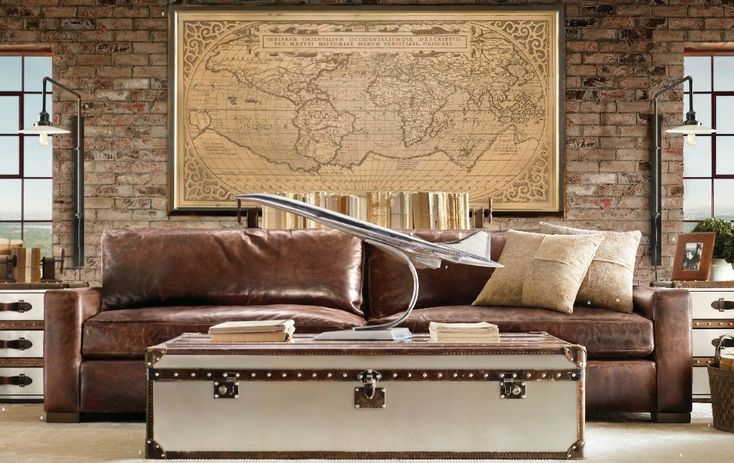 Aviation Themed living room.  Oversized map, leather couch, mixed metals.  Rustic and industrial!