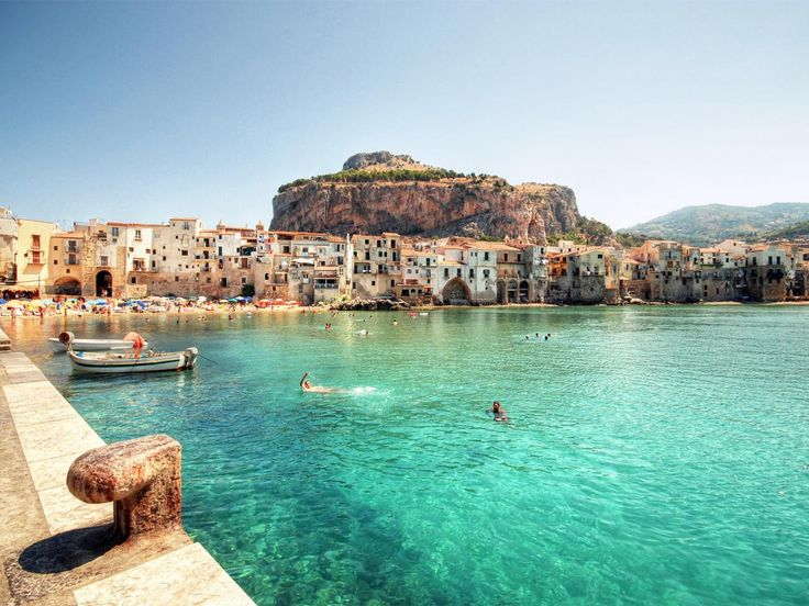 Sicily's many beaches include sandy white shores and exotic black sands, making for a unique island getaway.