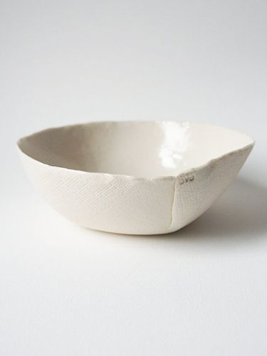 MACHA: Porcelain linen finish -ceramic bowl by Ovo. Artist Yuka Uchida's minimal idea was to create delicate, cloth-like dishes which would wrap items they hold. Perfect for holding jewelry items or used in a set for entertaining. $44