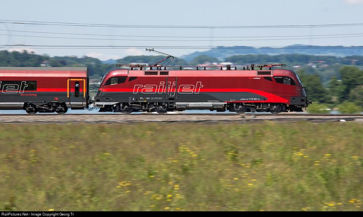 "Siemens ""Taurus"" 1116 201 of the Austrian Railways with a ""Railjet"" from Zürich to Vienna running with 110 km/h along Lake Zürich near Pfäffikon SZ. Pan shot with 1/80 seconds."