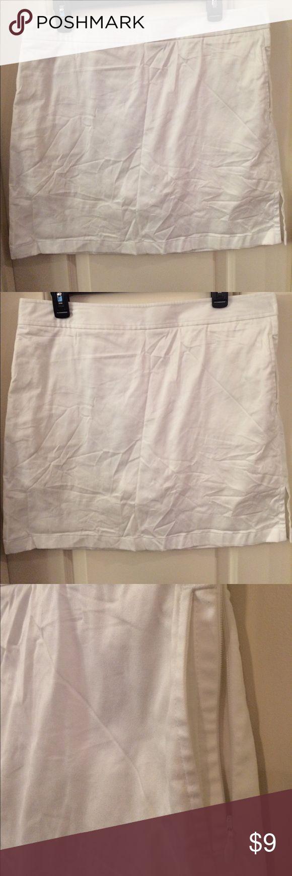 """Ashworth golf skort, size 10 White golf skort. Size 10. Side zip closure, side slash pocket and side slit. 98% cotton, 2% spandex. 18"""" long. Ashworth Shorts Skorts"""