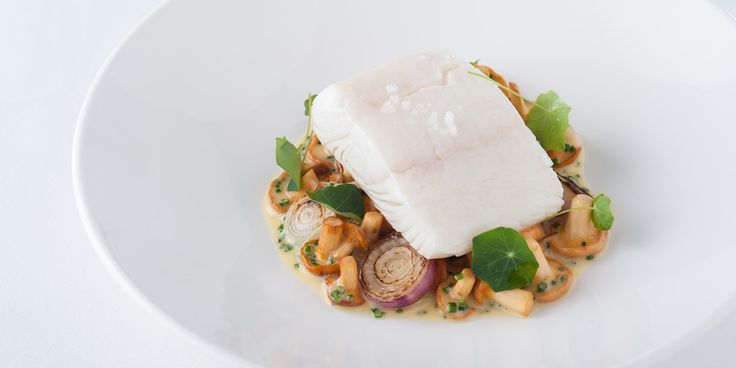 Simon Hulstone's poached halibut recipe makes an elegant starter, combining the sous vide fish with girolles, grelot onions and a rich butter and white wine sauce.
