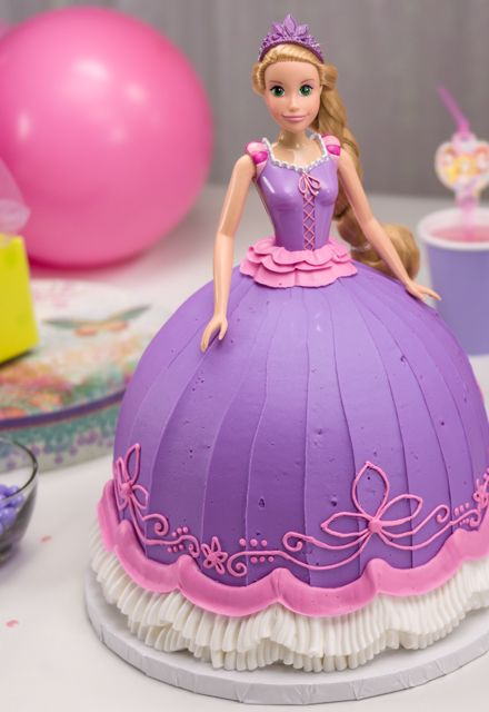Swooning over this pink & purple Disney Princess Rapunzel Doll Cake