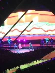 """Last night's show at the Palace of Auburn Hills, attended by a sold-out crowd of crazed KatyCats who braved one of the most torrential downpours in recent memory, was/is an epic tribute to one young person's (Perry's) astounding ability to crank out nearly two-dozen top ten hits in half a decade."" http://reelroyreviews.com/2014/08/12/two-parts-12-year-olds-slumber-party-one-part-bettie-page-pinup-calendar-katy-perrys-prismatic-world-tour-at-the-palace-of-auburn-hills/"