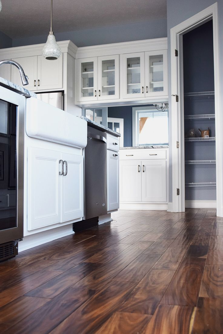 this dark hardwood is the perfect contrast to the white cabinets hardwood flooring - Dark Hardwood Hotel 2015