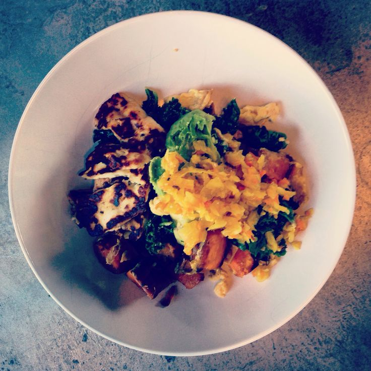 Sautéed kale and sweet potato scrambled eggs with avocado, sauerkraut and Haloumi. #guthealth #wellbeing