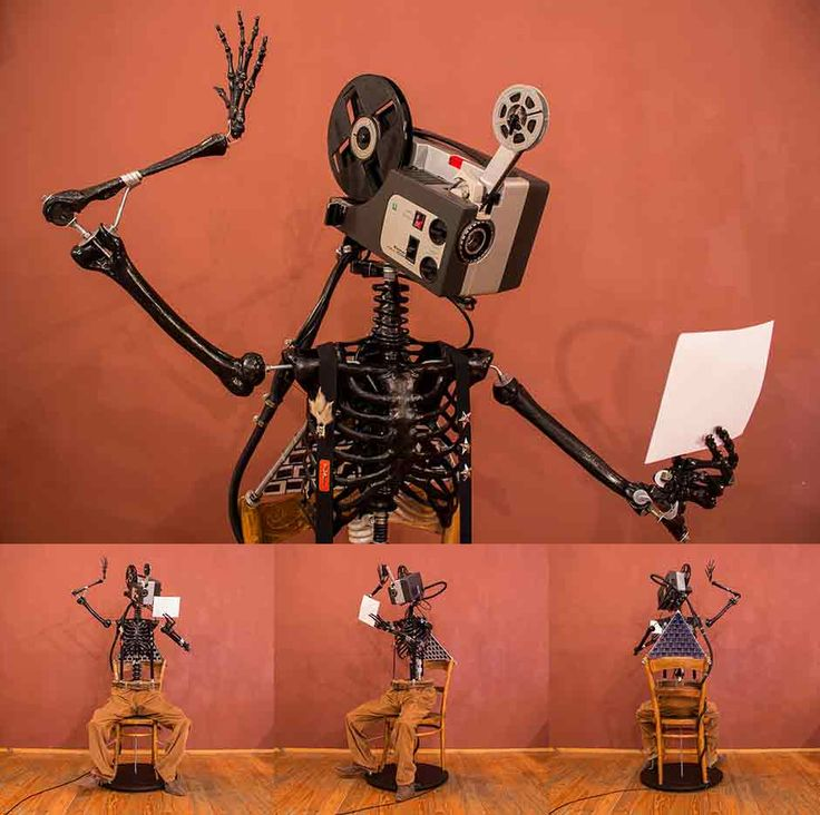 a Refurbished Vintage Sankyo Projector, mounted as a head on a plastic Human Skeleton. The Skeleton holds a white piece of paper onto which he projects his memories. His back is outfitted with old slides which are illuminated from below by a lightbulb.  see more @ the mind is right http://themindisright.com/Project/Reminiscence