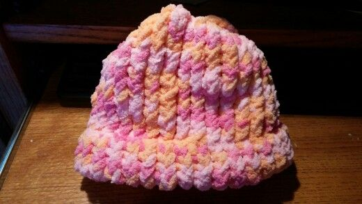 Loom knit baby hat used Bernat baby blanket yarn