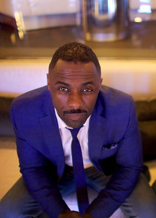 actor idris elba (Thor, Pacific Rim): bright blue suit, skinny tie