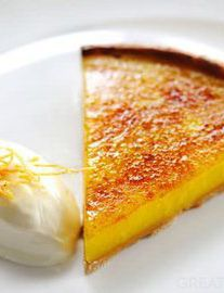 Glazed lemon tart with crème fraiche - Robert Thompson - fresh, zesty and very refreshing.---love the idea of brulee-ing the top of a lemon tart!