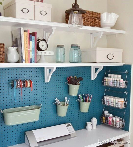 Love the area below the shelves with the peg board! Also like the idea of painting the pegboard to give a burst of color to the room.