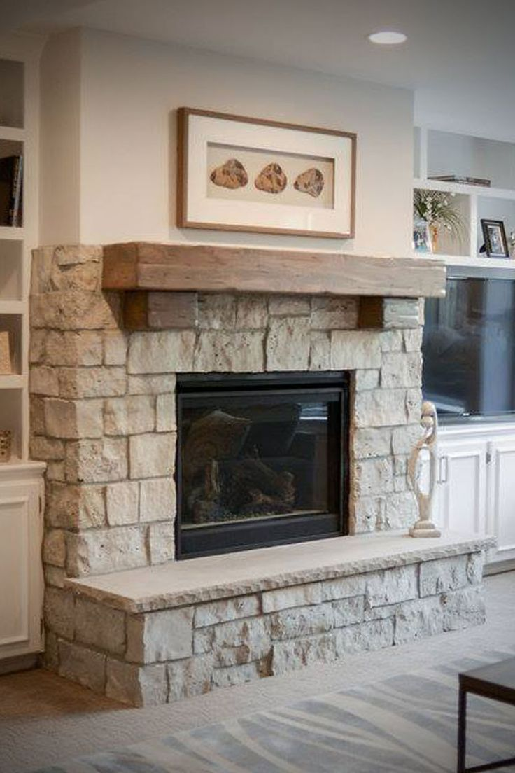 This cottage style fireplace uses a custom blend of - Stone fireplace surround ideas ...
