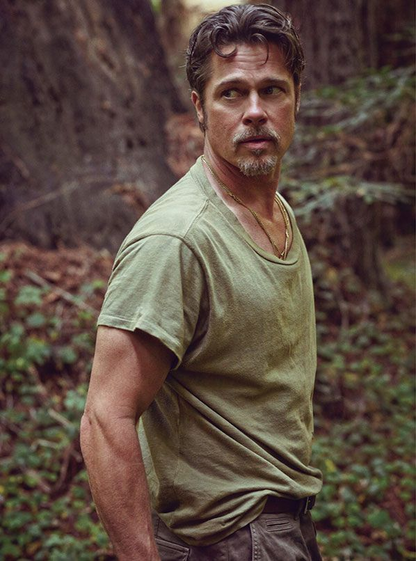 BRAD PITT, A PHOTO PORTFOLIO BY MARK SELIGER. T-shirt by Industry of All Nations. Pants by Belstaff.