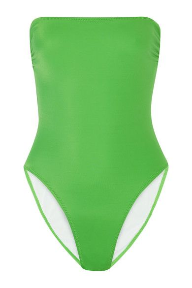 Norma Kamali's bright-green 'Bishop' swimsuit is an eye-catching choice for the beach. Crafted in the USA from a sculpting stretch fabric, thisflattering style is lined for a smooth fit and cut high at the leg to emphasize a svelte figure. Shop it now at NET-A-PORTER