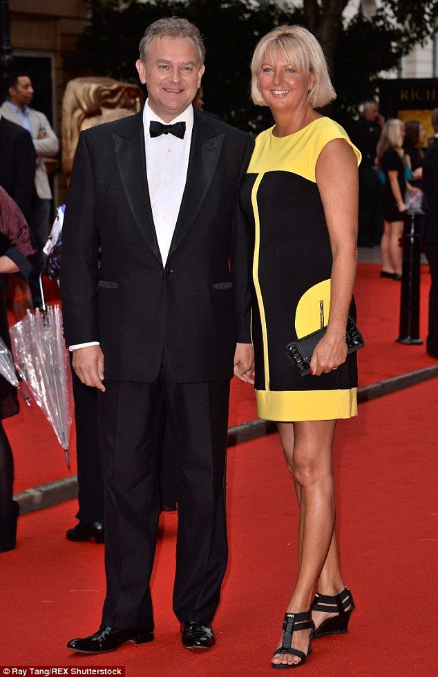 Dapper: Hugh Bonneville was joined by his wife Lucinda, who complemented her tan with a bold yellow and black mini dress...