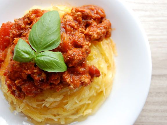 Paleo Spaghetti with Meat Sauce 1 spaghetti squash Extra virgin olive oil, for drizzling Salt and pepper 1 tsp dried oregano For the sauce 1 lb ground turkey or beef 1 small onion, chopped 4 cloves garlic, minced 1 tbsp coconut oil 1 tomato, chopped 1/2 jar of tomato sauce 1 tbsp Italian seasoning Salt and pepper to taste Fresh basil, for garnish