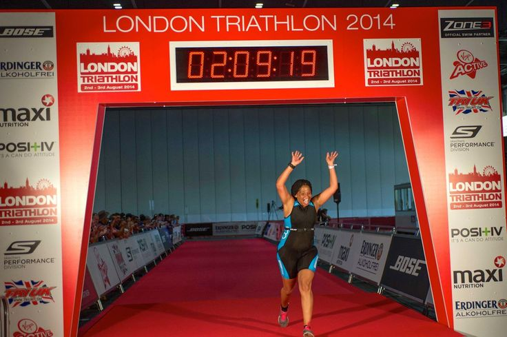 Female triathlete finishing London Triathlon