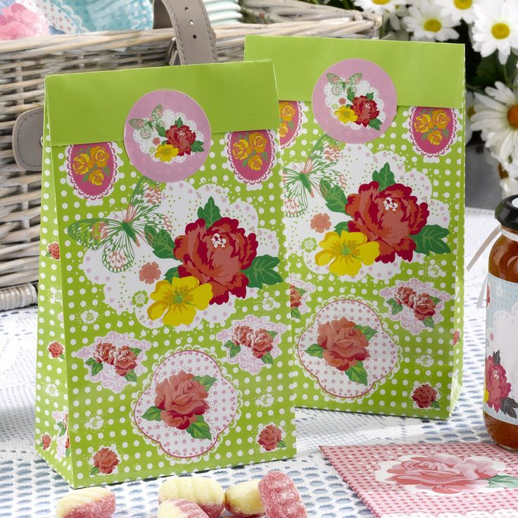 Bright and floral in design these colourful party bags, complete with sticker seals are a perfect touch for presenting sweets and gifts for your vintage summer wedding or celebration x8 £4.99 from www.fuschiadesigns.co.uk