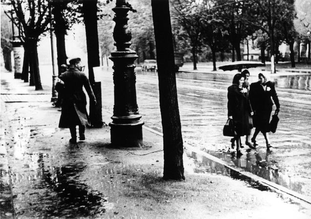 Riga, Latvia, Three Jewish women in the street. The Jews were forbidden to walk on sidewalks...one of the many new laws against Jews