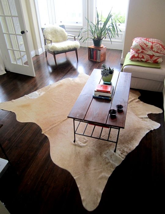 Cowhide Rugs: Perfect for Red Wine Enthusiasts & Klutzes