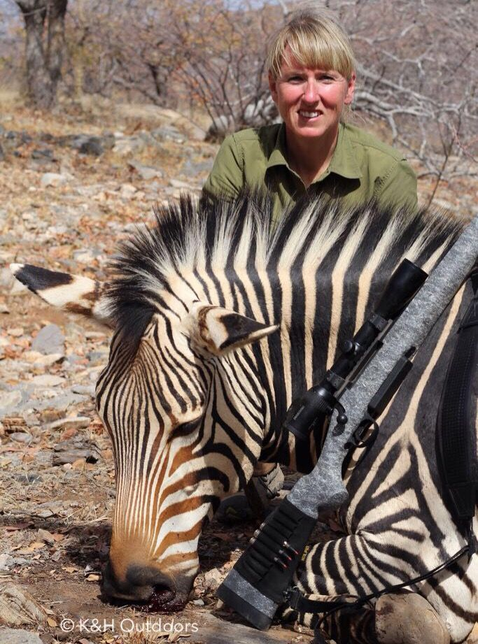 Heather Wilson, Co-Host of COTV, with a great Hartmann's zebra - taken with an HS Precision in 7mm Rem Mag topped with a Swarovski Z6i.