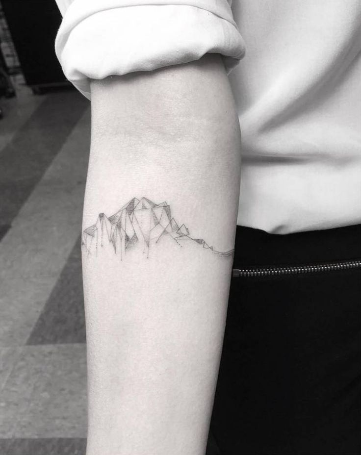 Fine line style cubist mountain range on the right inner forearm. Tattoo Artist: Dr. Woo