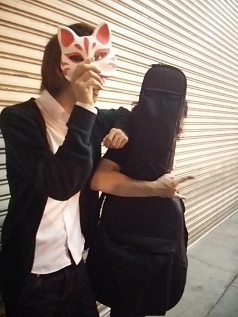 Haha, how cute! Both of them are hiding their faces from the camera!