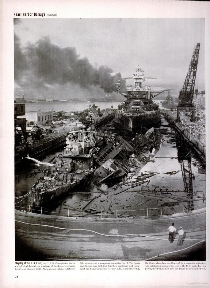 The USS Pennsylvania lies behind the wreckage of two destroyers at Pearl Harbor. Photo in LIFE magazine on Dec. 14, 1942.