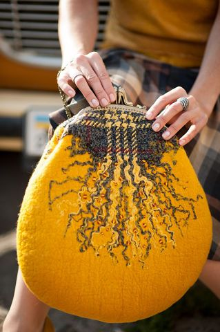 What a cool idea to use fibres separated from a piece of wool fabric to add detail to a felted project