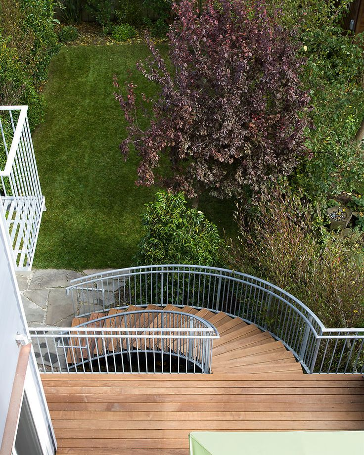 Outdoor Deck With Non Traditional Half Spiral Staircase