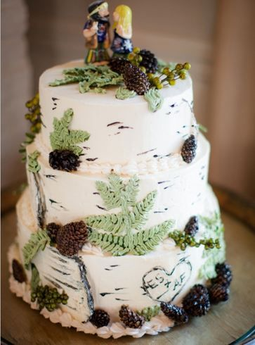 Camouflage nature wedding cake with leaves and cute couple cake topper