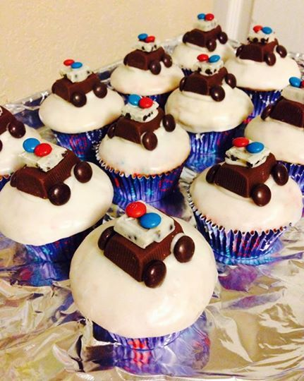 Police car cupcakes! =)   (Hershey's nugget bar, cookies and cream Hershey's bars, mini M&Ms, Reese's pieces, and frosting!)