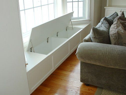 A flip-up lid reveals plenty of storage in this custom-made window seat. The storage compartments are made with particle board faced with white melamine that doesn't need painting and is easy to clean. You can figure a built-in window seat like this one will cost $1,300 to $1,800.