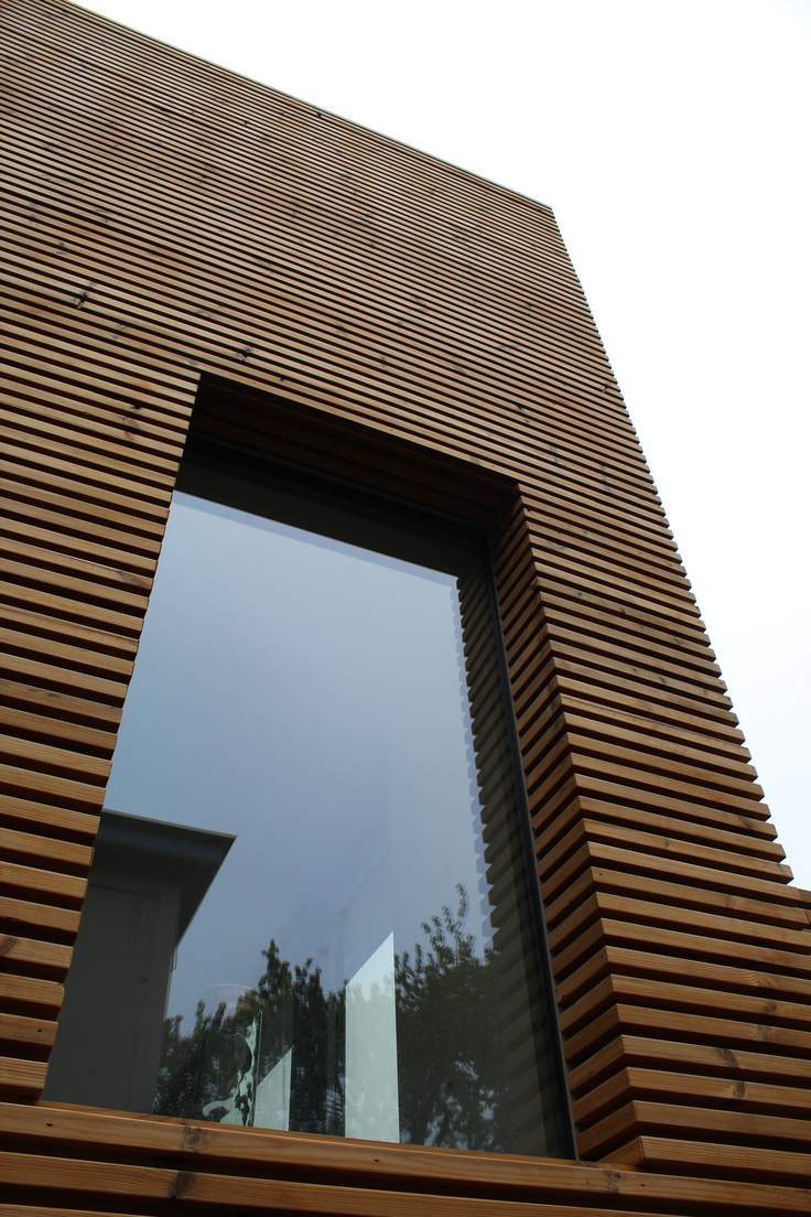 Extenson of a house in Ghent with thermowood for outdoor wall finishing.