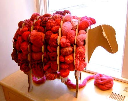 One of three sheep in our store's window - this one in pinks & reds